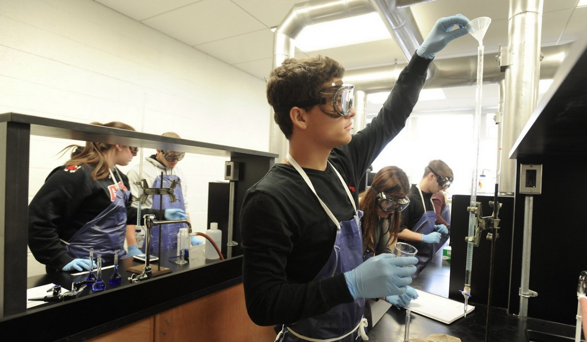 Student performing an experiment