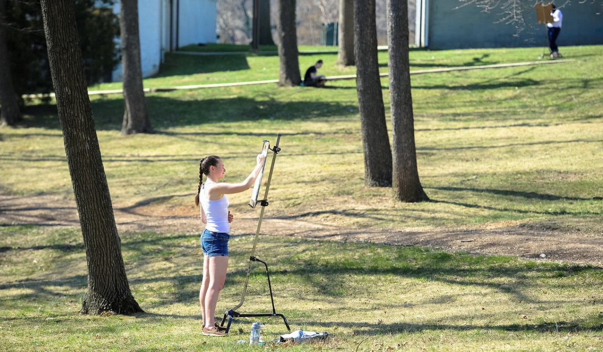 Student painting on campus