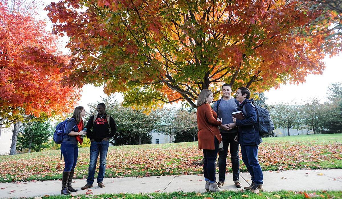 students talking on a fall afternoon