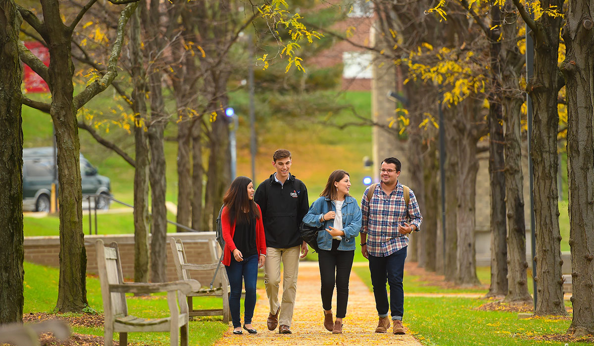 Students walking on campus in fall.