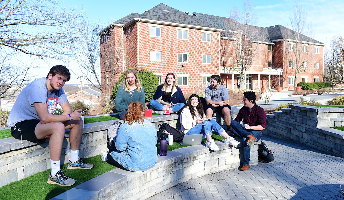 Students sitting in Centennial Village