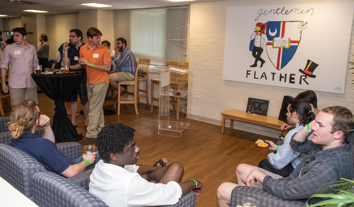 Male students in residence hall lounge area