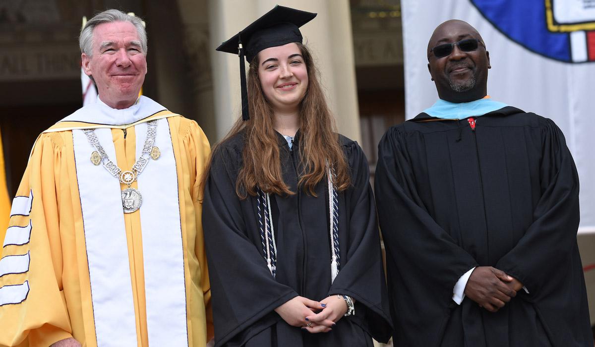 Taylor Stone with President John Garvey and Alumni President Rashaun Martin