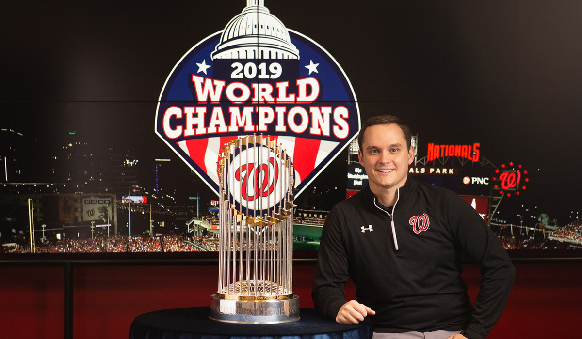 Alumnus Kevin Kelley with World Series trophy