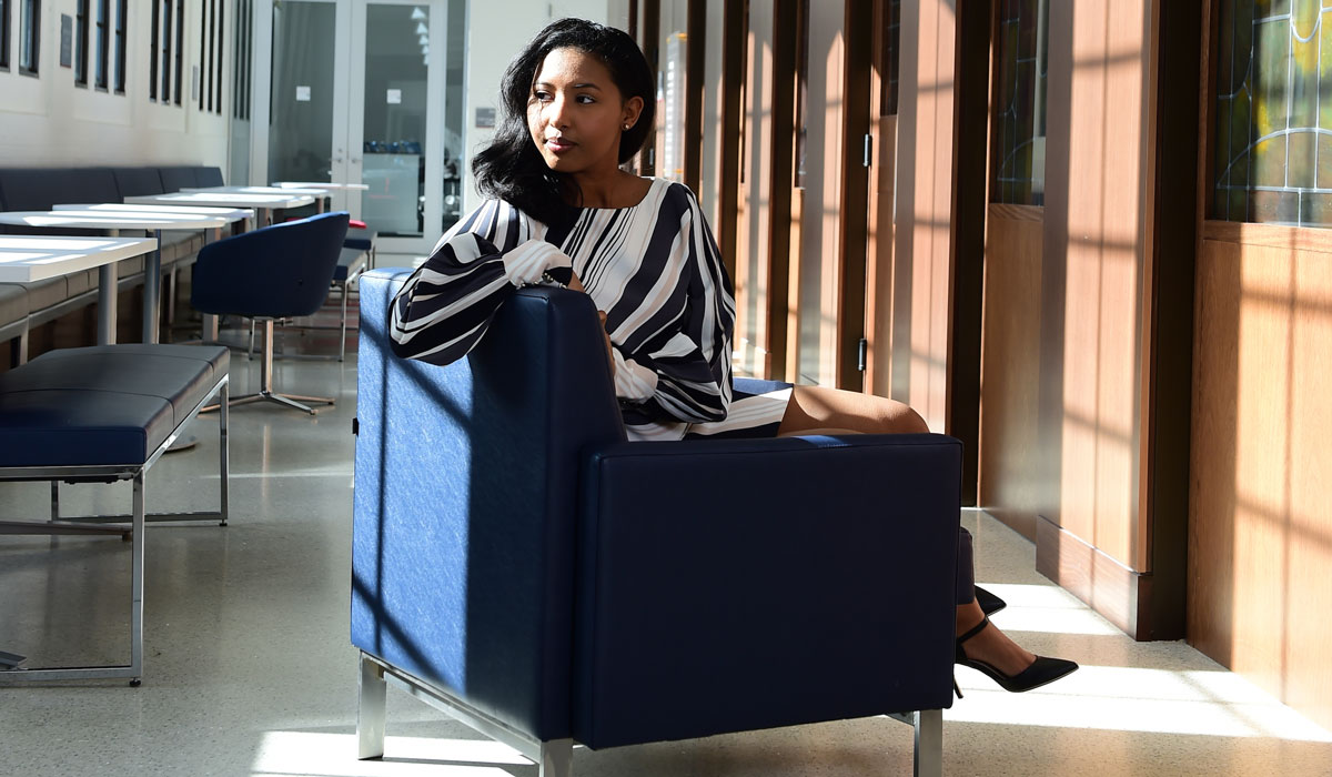 Female student sitting in a chair in the business school