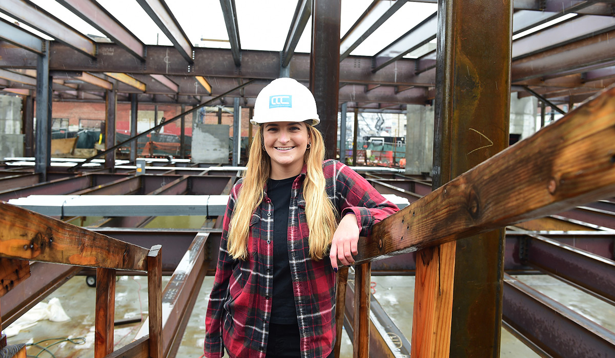Female engineering alumna at a construction site