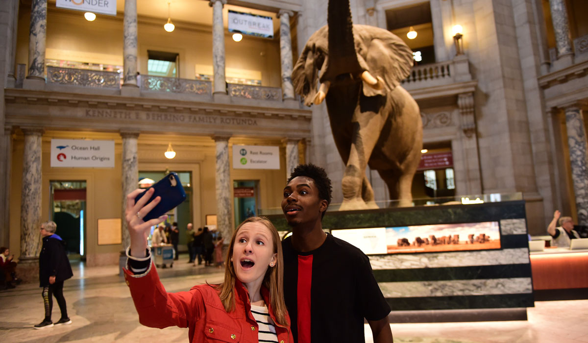 Students taking a selfie at the Natural History Museum
