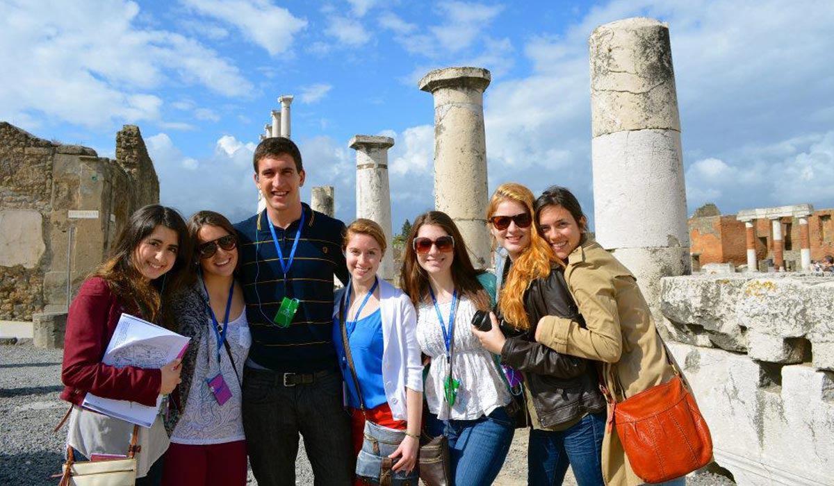 A group of CUA students posing for a picture abroad
