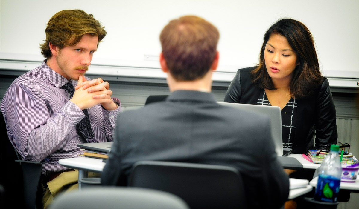 Students discussing topic with professor
