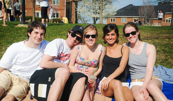 CUA students hanging out in front of residence halls