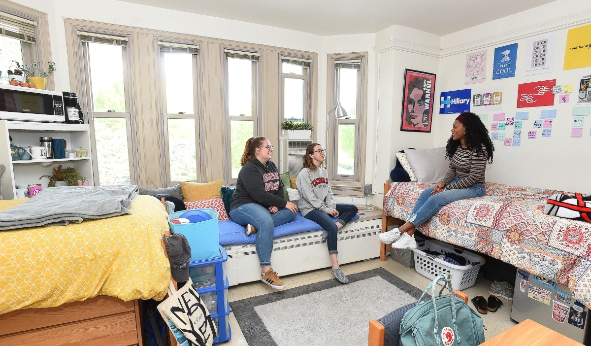 Female students in residence hall room