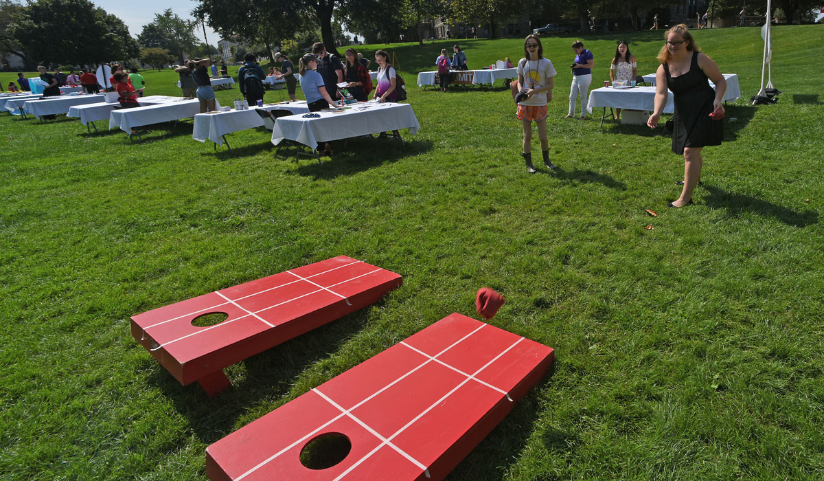Female student playing cornhole