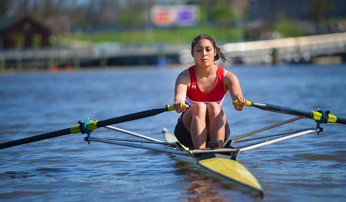 CUA Rowing Association (CUA Crew) member rowing on river