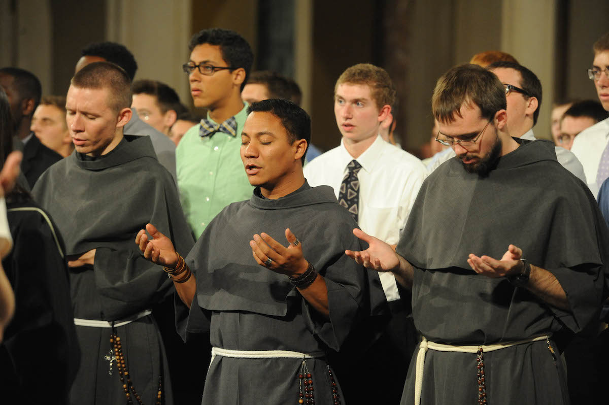 Franciscan Friars praying the Lord's Prayer