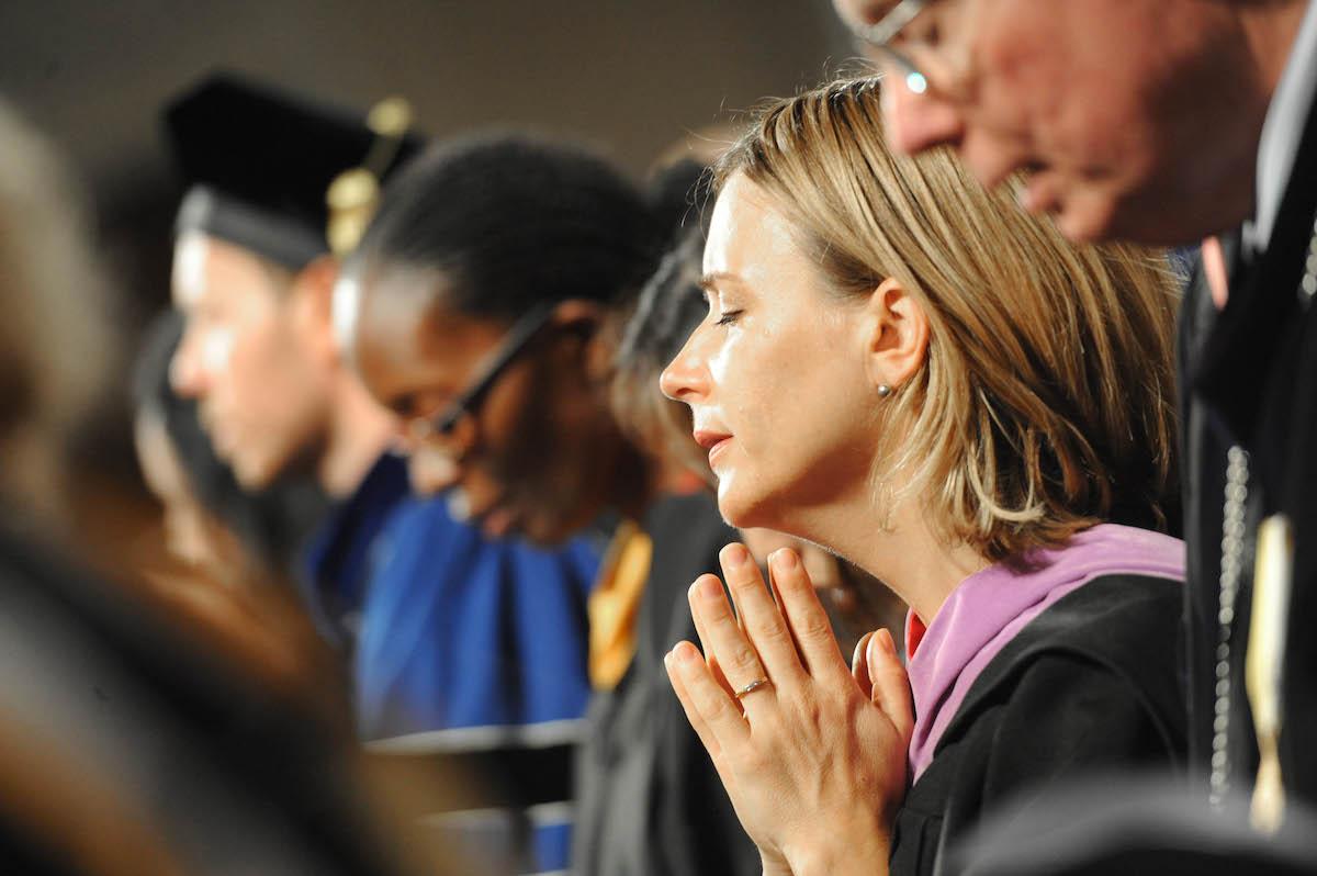 Faculty praying