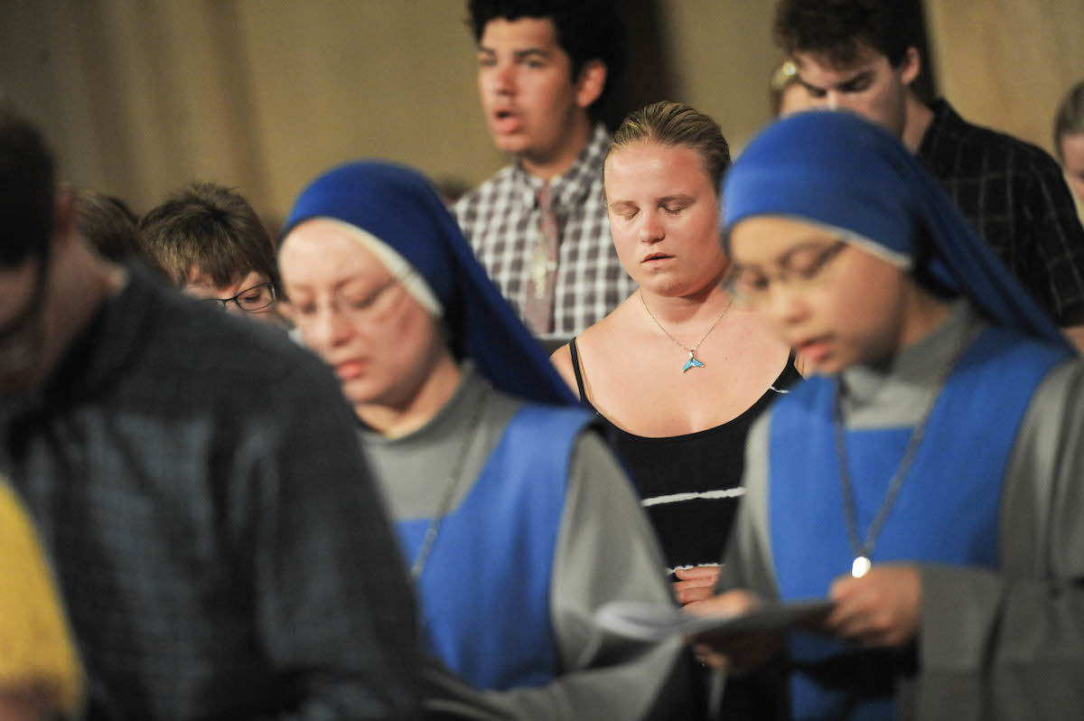 Students singing and praying