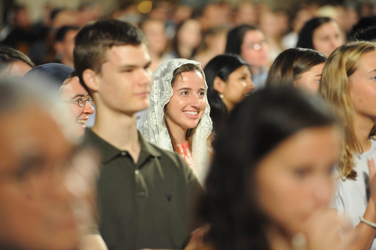 Students listening to the homily