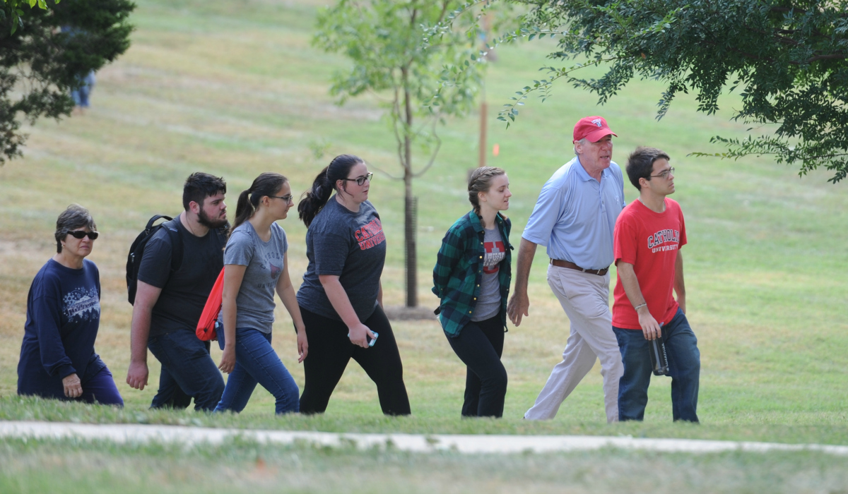 President Garvey and students walking through campus