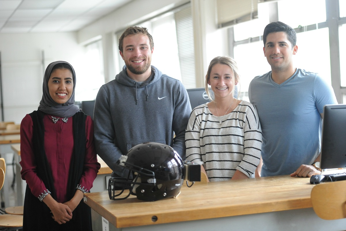 Student team invents football helmet device to teach safe tackling