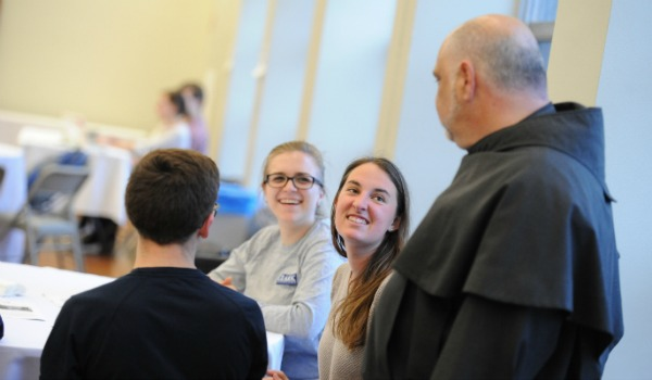 Campus Minister chatting with students
