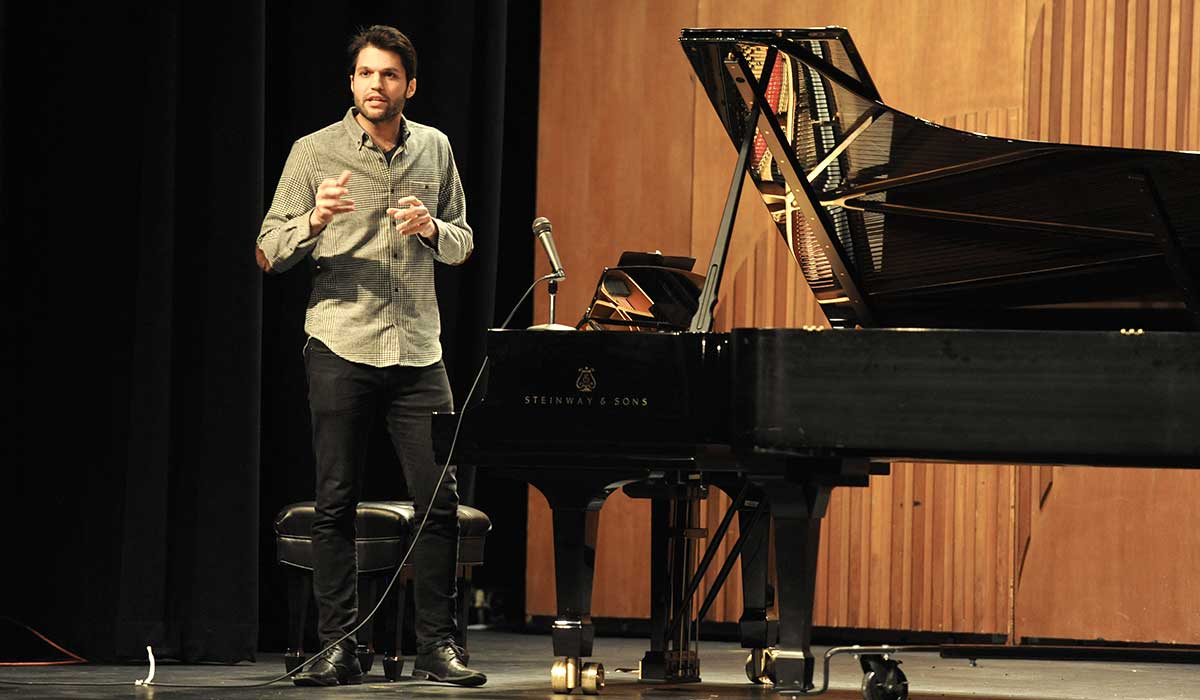 Music graduate student Jason Solounias talks about his research into the Melodramas of Franz Liszt before sitting down at the piano to play a selection.