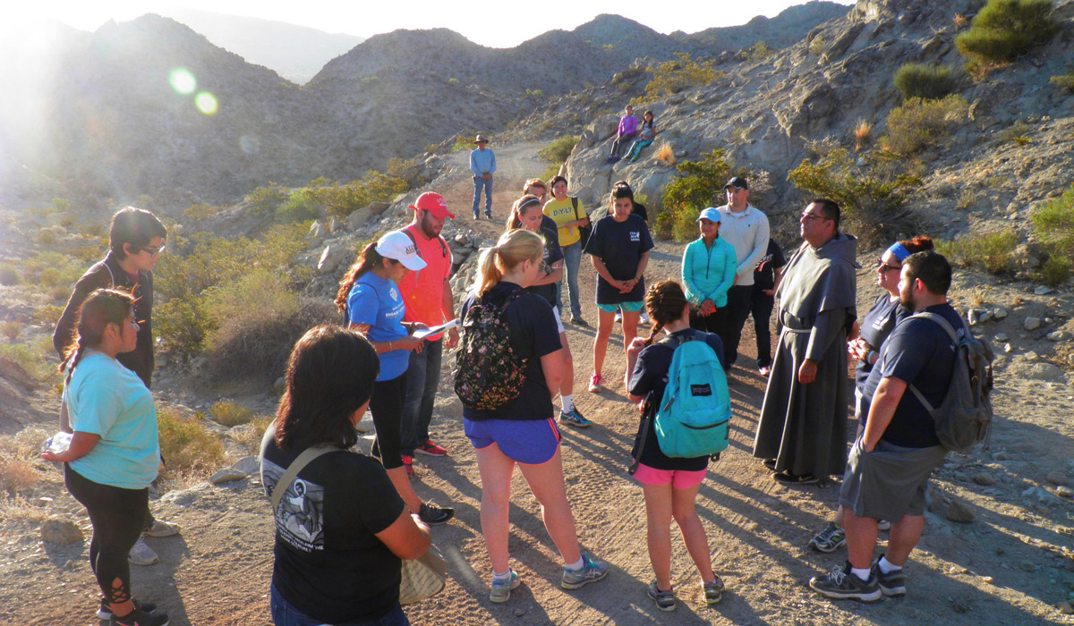 Students pray the Stations of the Cross while climbing Cristo Rey