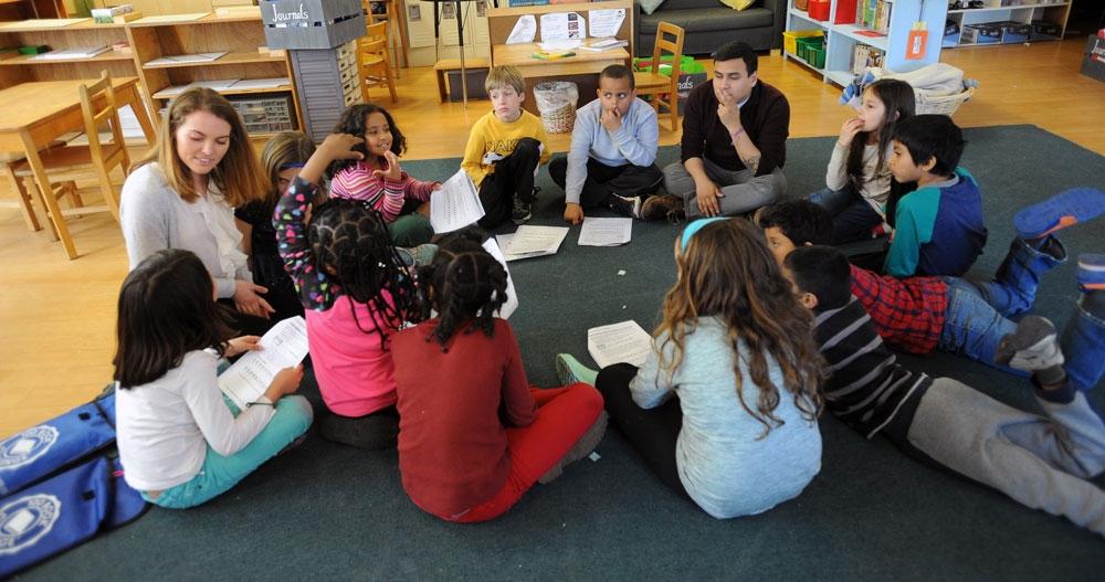 Kelly Dossena reading a story to children