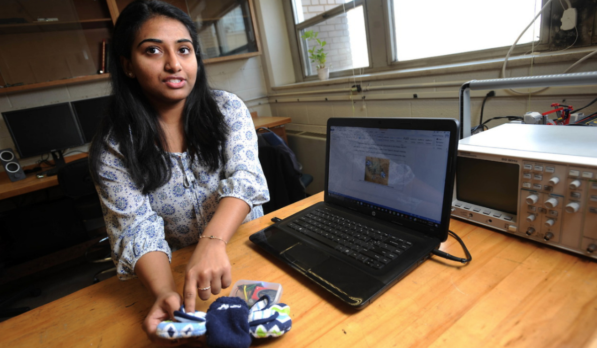 Senior Catherine Premaj shows off her biomedical engineering senior design project, a feedback device for infants with motor deficiencies. Over the summer, Premaj worked as an intern at Anthrotonix, a research and design company in Silver Spring, Md.