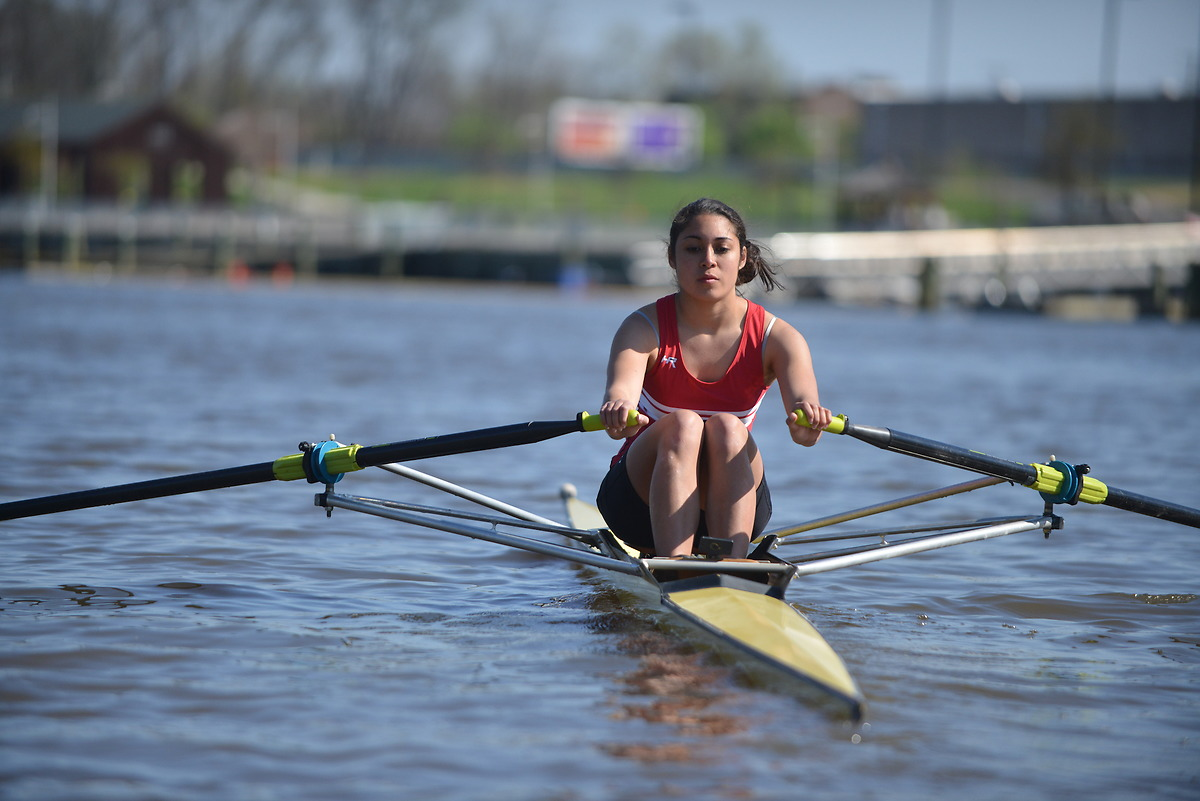 Girl rowing for CUA team