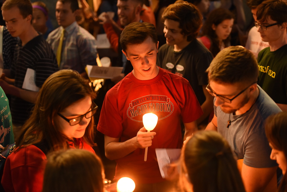 Students sing and pray at a candle-lit prayer service on campus.