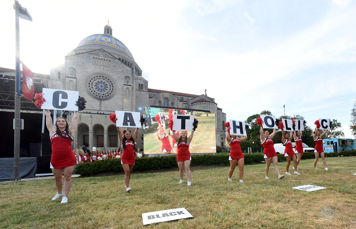 CUA Cheerleaders cheering in front of Basilica