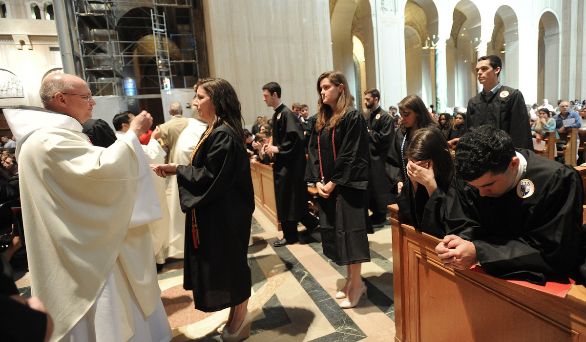 Students receive Communion at 2016 Baccalaureate Mass