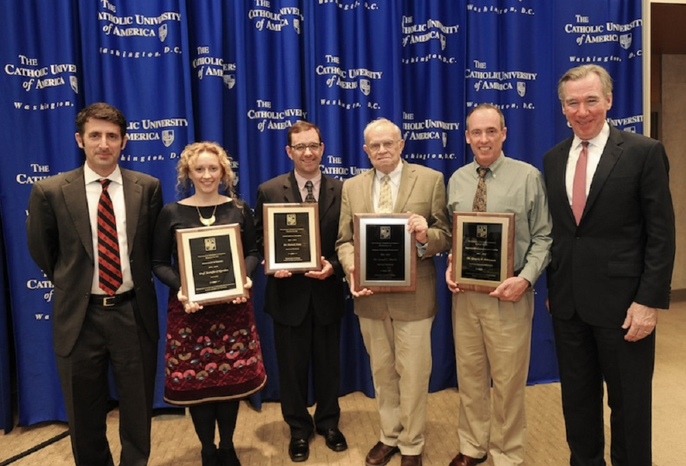 Provost Andrew Abela, left, and President John Garvey, right, stand with faculty teaching award winners, from left, Jennifer O'Riordan, Patrick Tuite, Joseph Shields, and Gregory Behrmann.