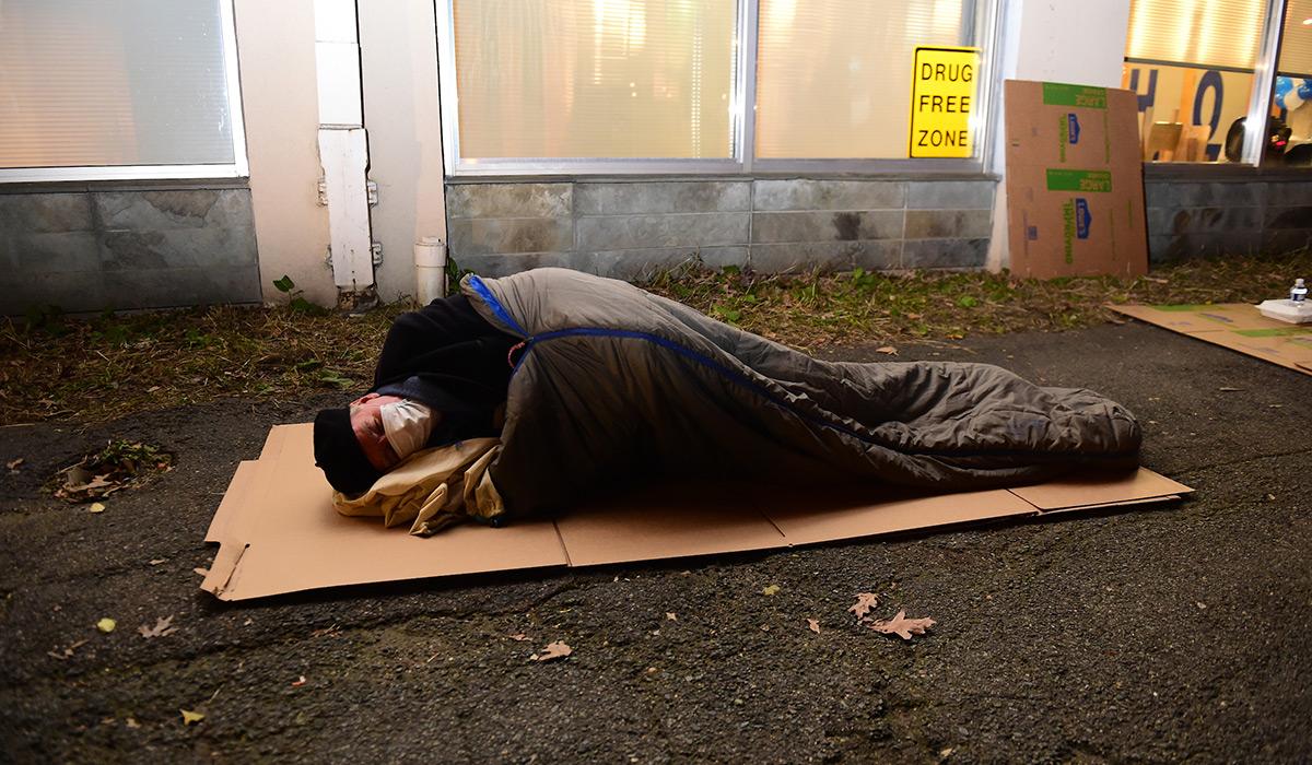 President John Garvey sleeping on the ground outside Covenant House