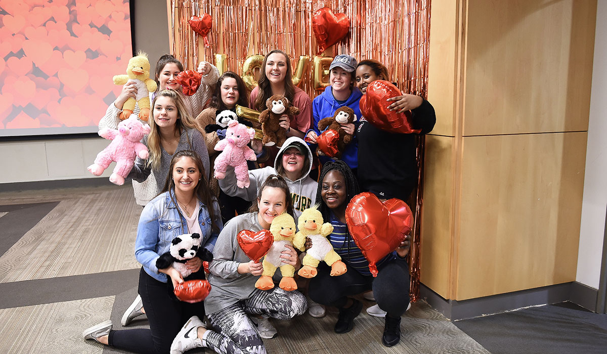 Students posing with stuffed animals
