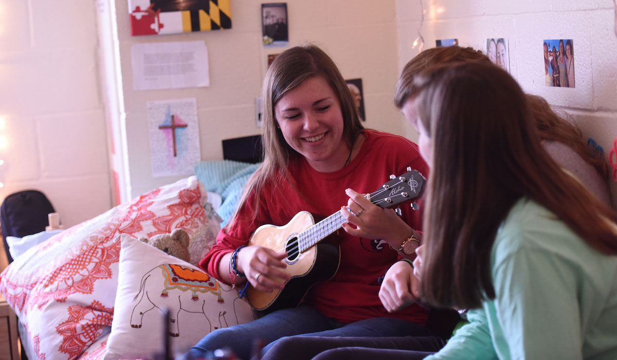 Student playing music in residence hall