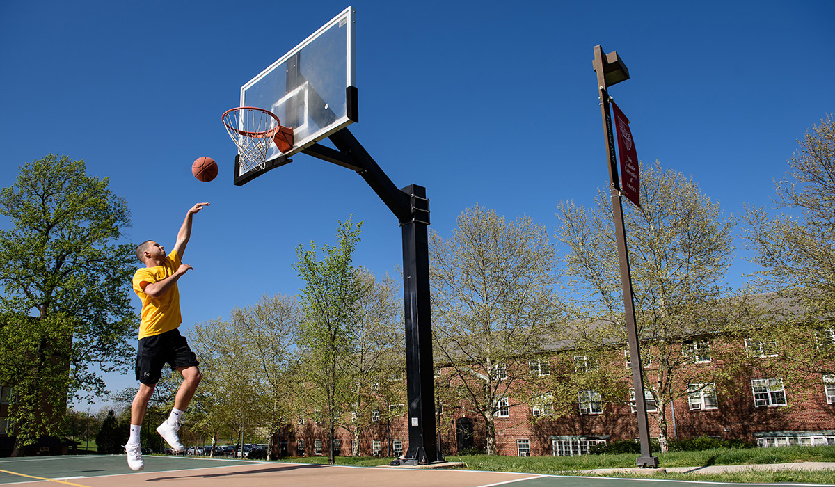 Student playing basketball