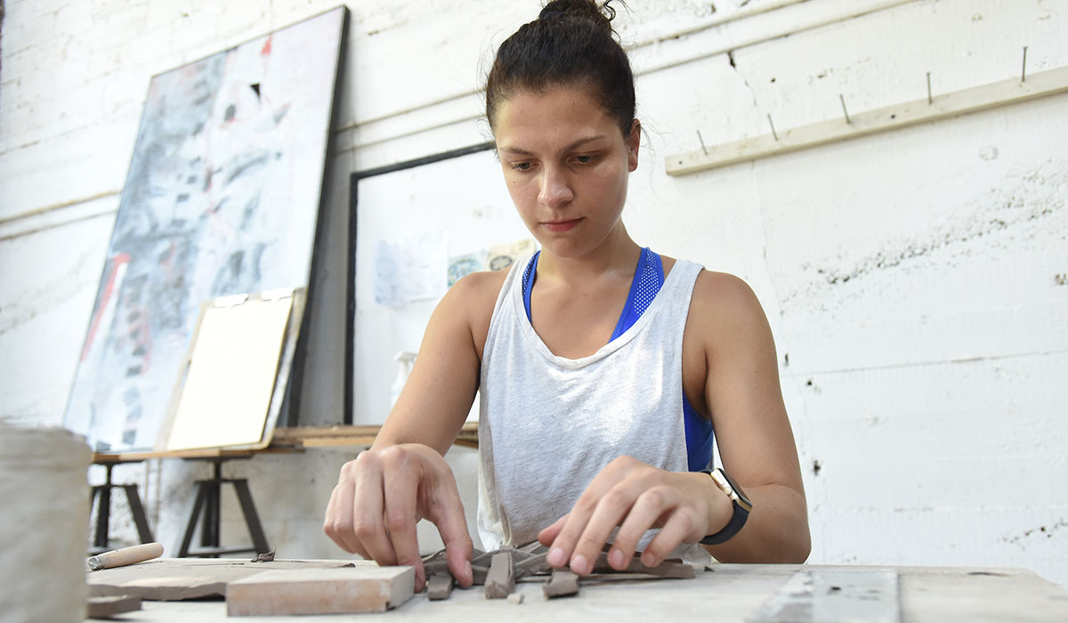 Student working in a ceramics class