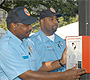 Campus Safety Officers activate an emergency phone.