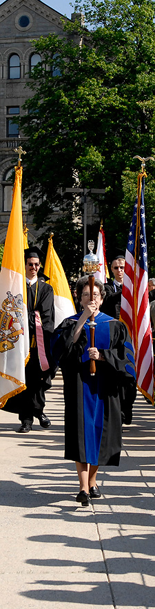 The CUA Commencement Procession lead by the Mace Bearer.
