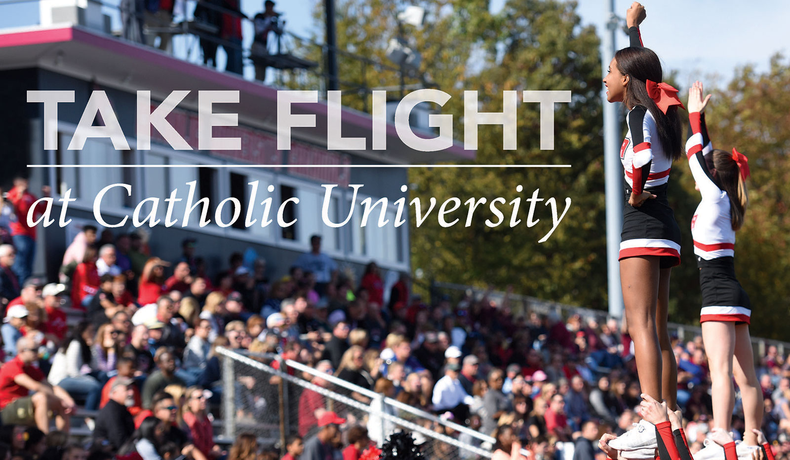 Cheerleaders leading crowd in cheer. Text on image reads Take Flight at Catholic University